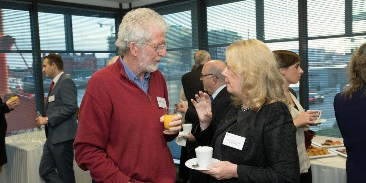 Photo of two people having a discussion at Beauchamps charities event 2017